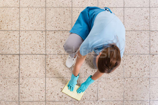 Janitor Rubbing Floor With Rag Stock photo © AndreyPopov