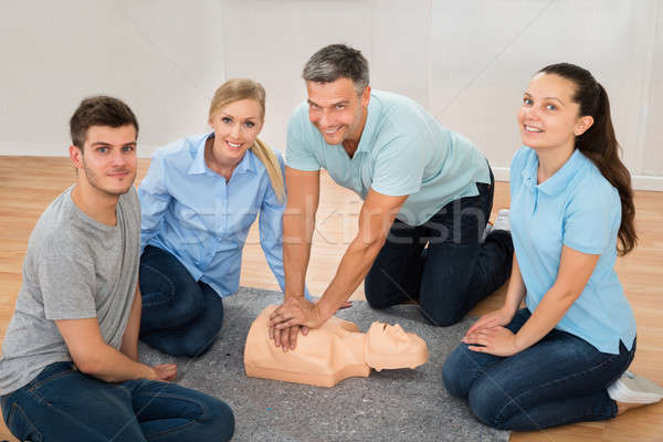 Instructor Showing Cpr Training On Dummy Stock photo © AndreyPopov