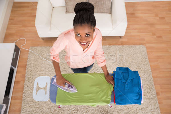 Woman Ironing Clothes On Iron Board Stock photo © AndreyPopov