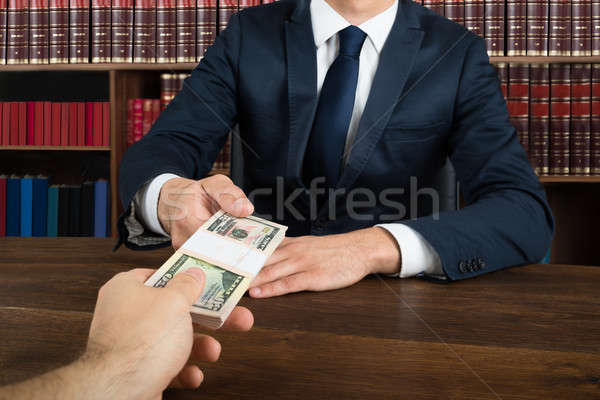 Lawyer Taking Bribe From Client At Desk Stock photo © AndreyPopov
