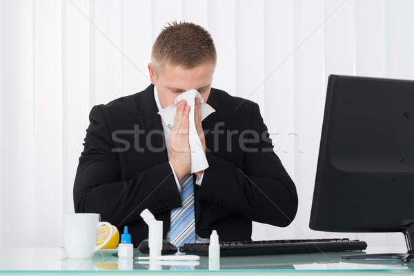 Sick Businessman Blowing His Nose Stock photo © AndreyPopov