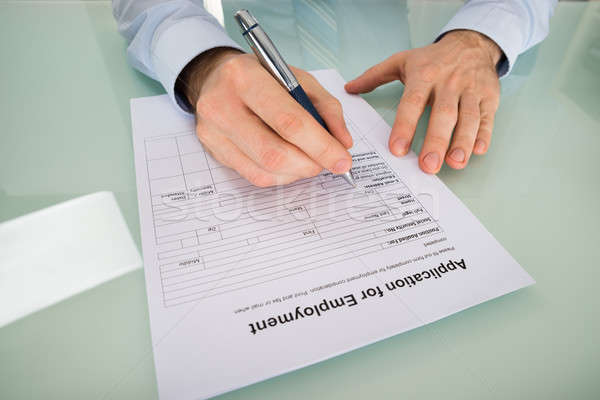 Person Hand Filling Application For Employment Form Stock photo © AndreyPopov