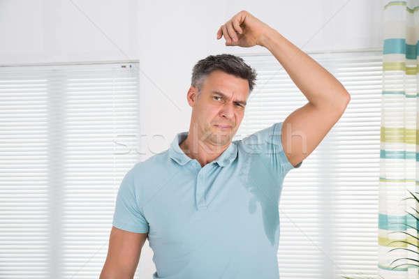 Homme transpiration aisselle maison maison chambre Photo stock © AndreyPopov
