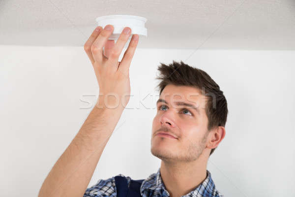 Male Electrician Testing Smoke Detector Stock photo © AndreyPopov
