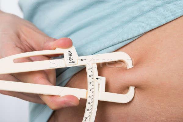 Férfi mér gyomor kövér közelkép test Stock fotó © AndreyPopov