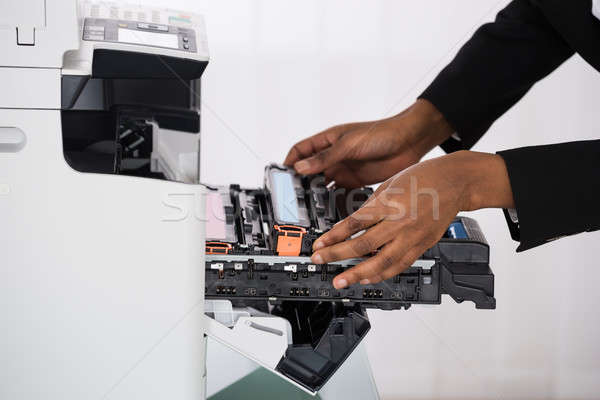 Businesswoman Hand Fixing Photocopy Machine Stock photo © AndreyPopov