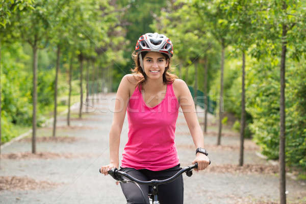 Female Cyclist Riding On Bicycle Stock photo © AndreyPopov