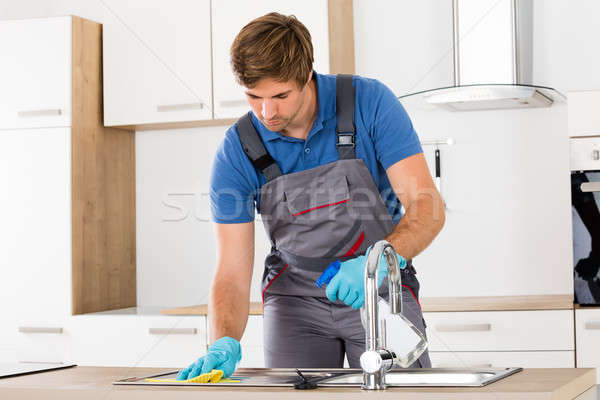 Lavoratore indossare guanto pulizia giovani Foto d'archivio © AndreyPopov