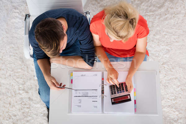 Couple Using Calculator For Calculating Invoice Stock photo © AndreyPopov
