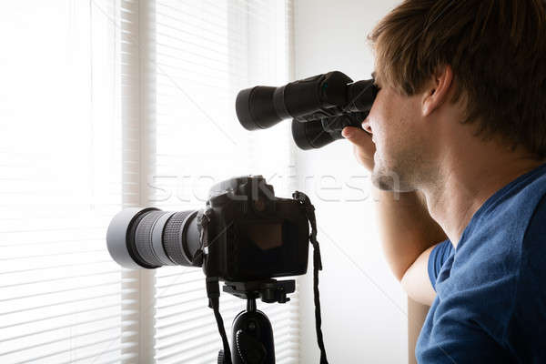 Man Spying With Binoculars Stock photo © AndreyPopov