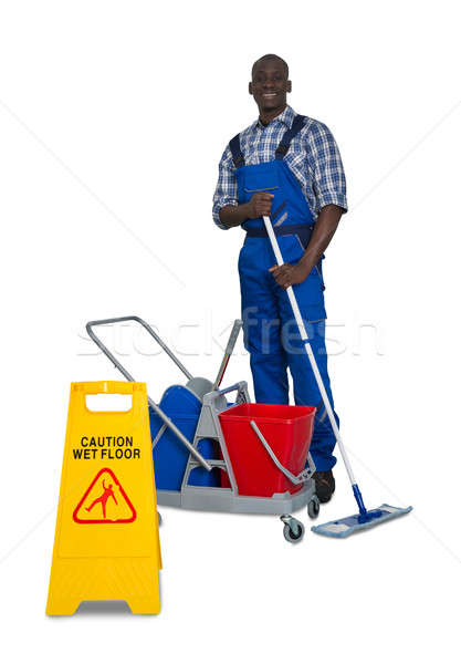 Afrikaanse mannelijke schoonmaken vloer jonge Stockfoto © AndreyPopov