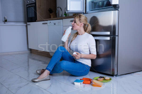 Woman Drinking Milk In The Kitchen Stock photo © AndreyPopov