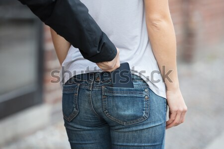 Person Stuffed His Mobile Phone On His Pants Stock photo © AndreyPopov