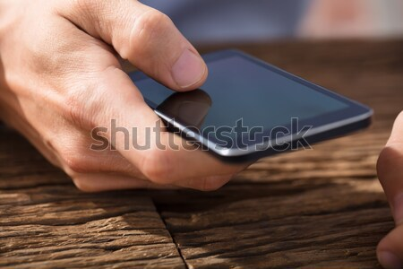 Hand Using Smart Phone Stock photo © AndreyPopov