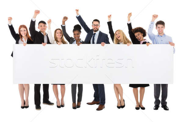 Stock photo: Businesspeople Holding Long Blank Banner