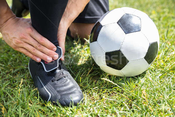 Male Soccer Player Suffering From Ankle Injury Stock photo © AndreyPopov