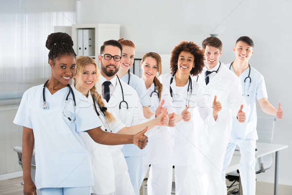 Multi Ethnic Male And Female Doctors Showing Thumb Up Sign Stock photo © AndreyPopov
