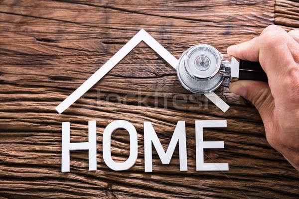 Személy kéz tart sztetoszkóp otthon szöveg Stock fotó © AndreyPopov