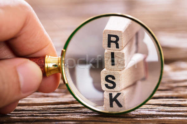 Person Inspecting Risk Block With Magnifying Glass Stock photo © AndreyPopov