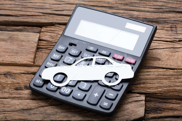 Paper Car On Calculator At Wooden Table Stock photo © AndreyPopov