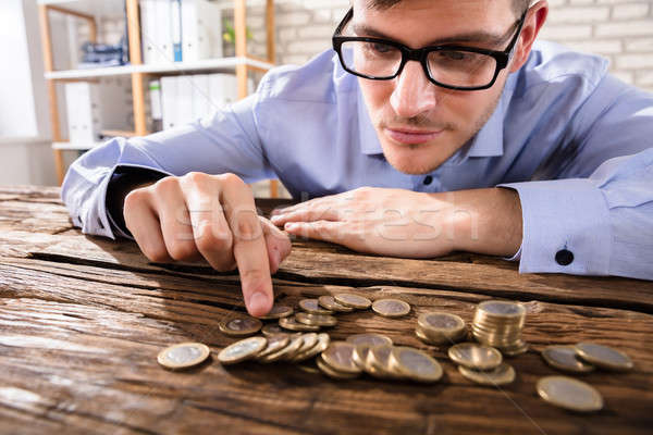 Close-up Of A Businessman Counting Coins Stock photo © AndreyPopov