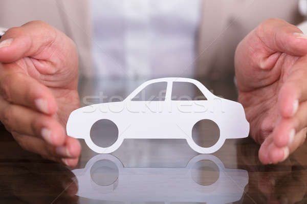 Person's Hand Protecting Car Cut Out Stock photo © AndreyPopov