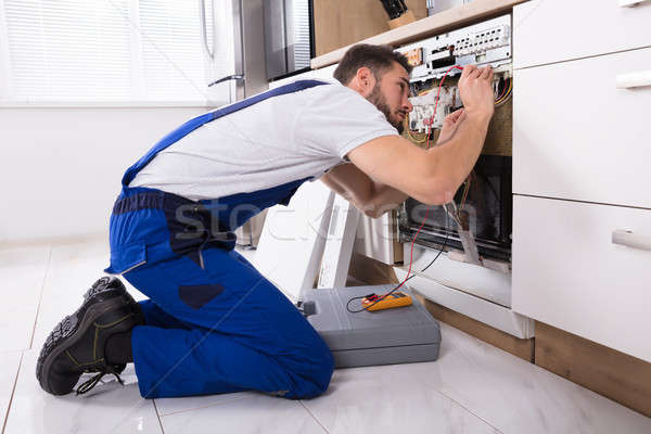 Male Technician Examining Dishwasher Stock photo © AndreyPopov