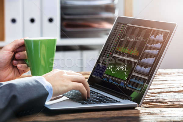 Stock Market Broker Working With Graphs On Laptop Stock photo © AndreyPopov