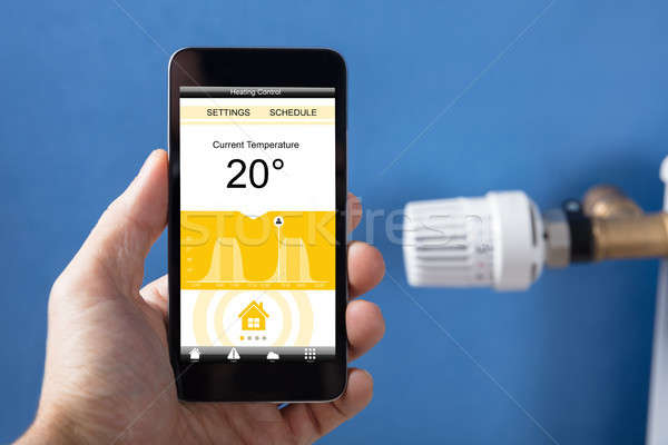 Personne main température thermostat internet Photo stock © AndreyPopov