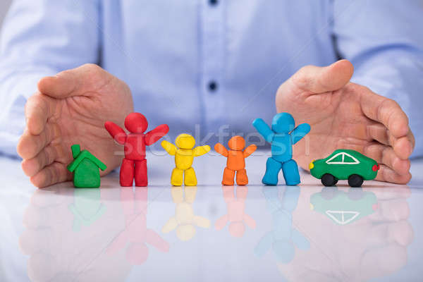 Hand Protecting The Colorful Clay Family, Car And House Stock photo © AndreyPopov