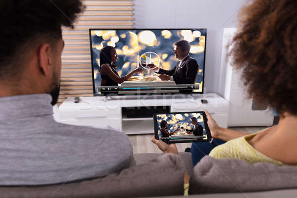 Couple Connecting Television Through WiFi On Digital Tablet Stock photo © AndreyPopov