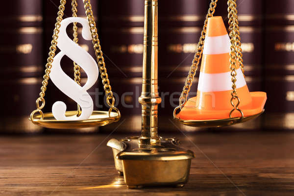 Paragraph Symbol And Traffic Cone On Justice Scale Stock photo © AndreyPopov