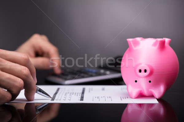 Rosa piggy bank de cabeça para baixo empresário escritório Foto stock © AndreyPopov