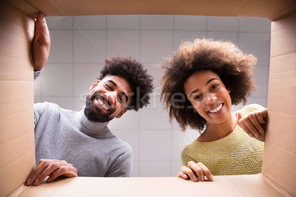 Happy Couple Looking Inside Cardboard Box Stock photo © AndreyPopov