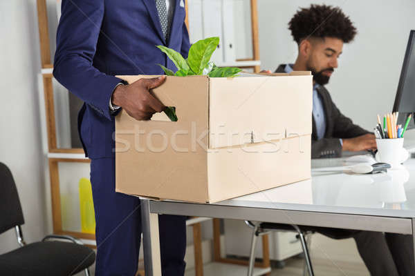 Businessperson Packing Belongings In Cardboard Box Stock photo © AndreyPopov