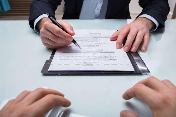 üzletember tart toll önéletrajz közelkép kéz Stock fotó © AndreyPopov