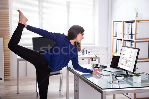 Young Businesswoman Doing Yoga Stock photo © AndreyPopov