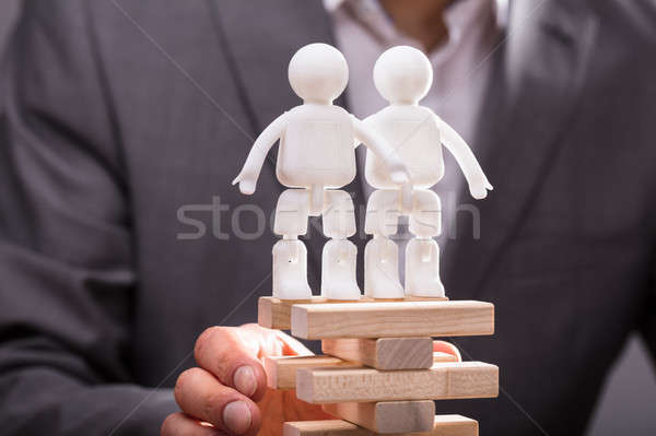 Two Human Figures Standing On Top Of Stacked Wooden Blocks Stock photo © AndreyPopov
