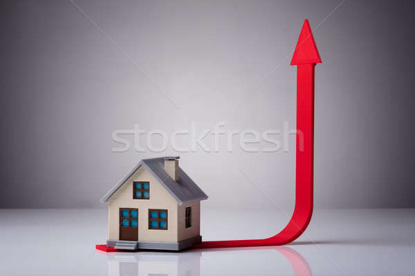 Close-up Of House Model On Red Arrow Stock photo © AndreyPopov