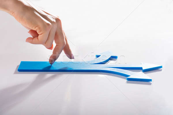 Woman's Finger Walking On Blue Arrows Stock photo © AndreyPopov
