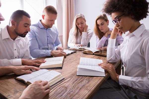 Group Of Young Multiethnic People Reading Bible Stock photo © AndreyPopov