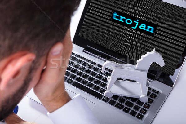 Empresário laptop tela troiano texto Foto stock © AndreyPopov
