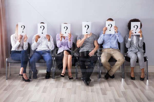Menschen halten Fragezeichen Zeichen Gesicht Business Stock foto © AndreyPopov