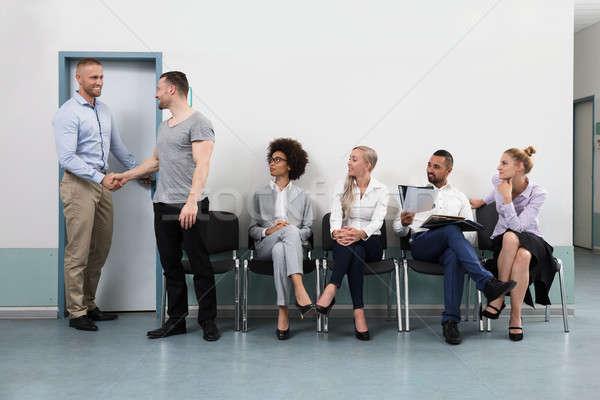 ビジネスマン 握手 男性 候補者 笑みを浮かべて 小さな ストックフォト © AndreyPopov