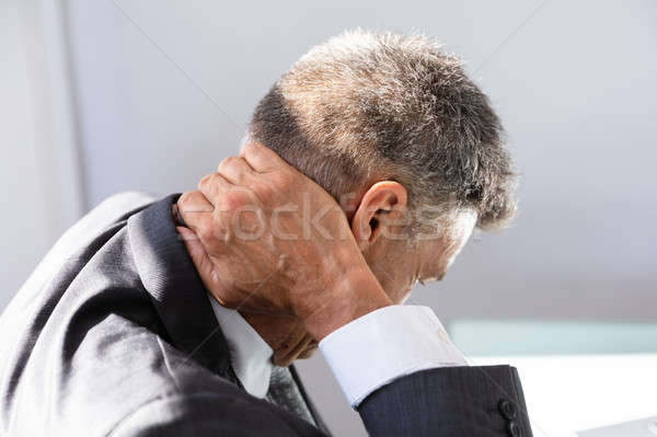 Businessman Having Neck Pain Stock photo © AndreyPopov