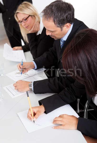 Stock fotó: üzletemberek · jegyzetel · csoport · megbeszélés · nő · iroda
