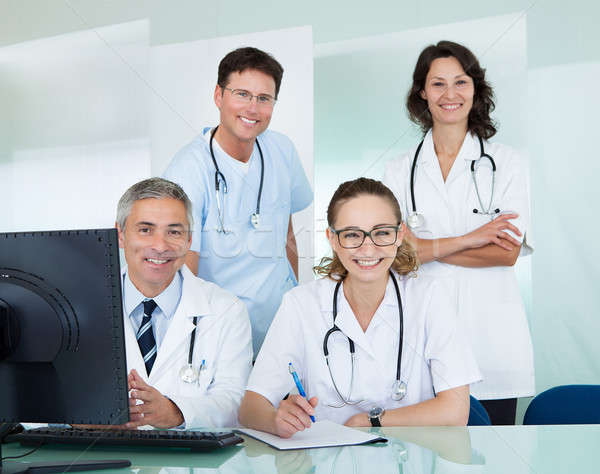 Medical team posing in an office Stock photo © AndreyPopov