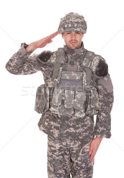 Portrait Of Man In Military Uniform Saluting Stock photo © AndreyPopov