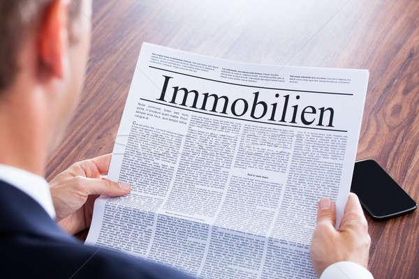ストックフォト: ビジネスマン · 読む · 新聞 · 見出し · 不動産 · お金