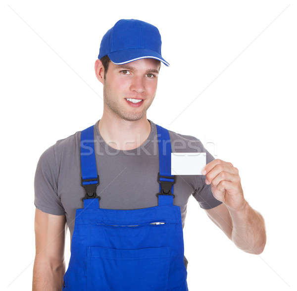 Mechanic Holding Visiting Card Stock photo © AndreyPopov